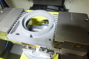 (Photo reference ETG Renishaw Matrix PR1) The machining set up on a RoboDrill D21L 3 axis machining centre fitted with a 4/5 axis rotary table.