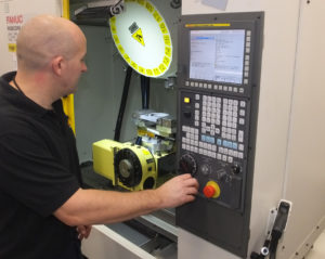 (Photo reference ETG Renishaw Matrix PR3) The machining set up on a RoboDrill D21L 3 axis machining centre fitted with a 4/5 axis rotary table.