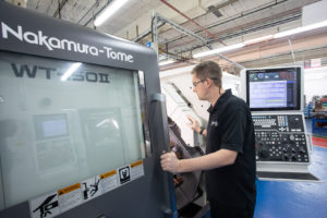 The use of a Nakamura-Tome CNC machine.